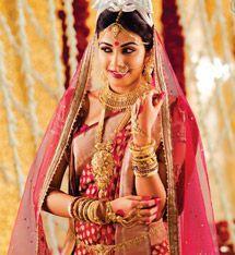 bengali bride wearing shaka and pola