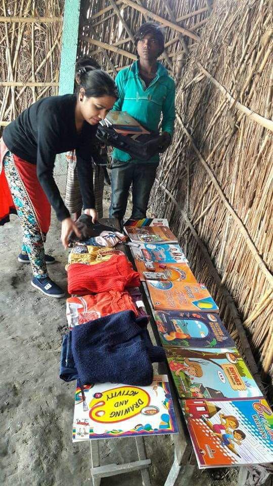 Sarita assembling books