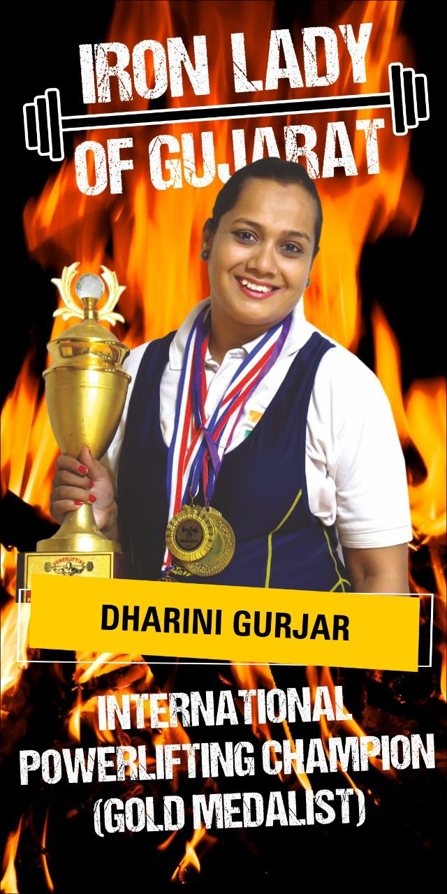 dharini holding the iron late trophy