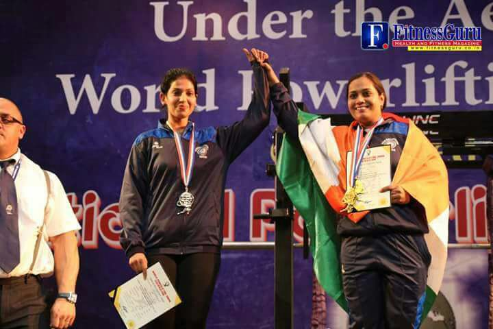 dharini's holding hand with gold medal