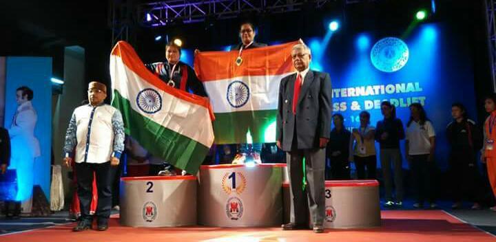 dharini at podium being declared winner