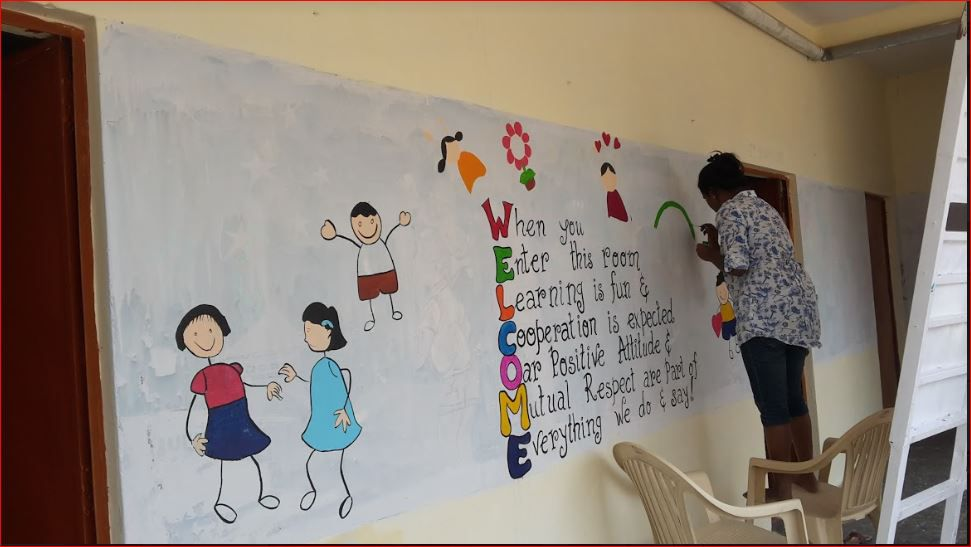 kavya creating a message on school wall