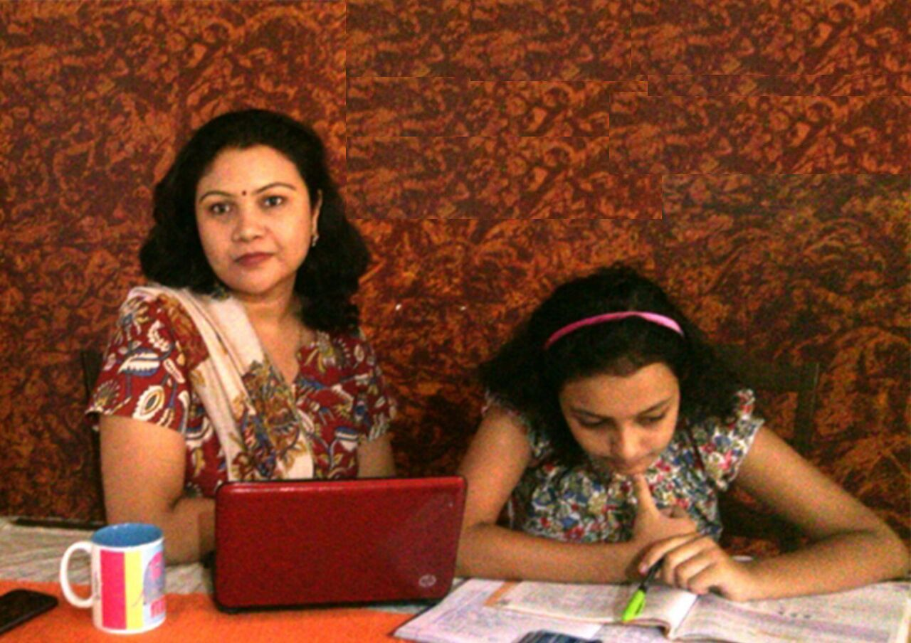susmita with daughter and laptop
