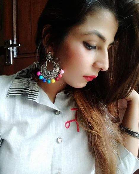 swati wearing earrings