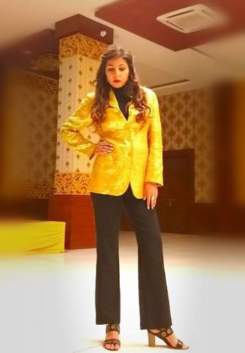 swati wearing yellow jacket