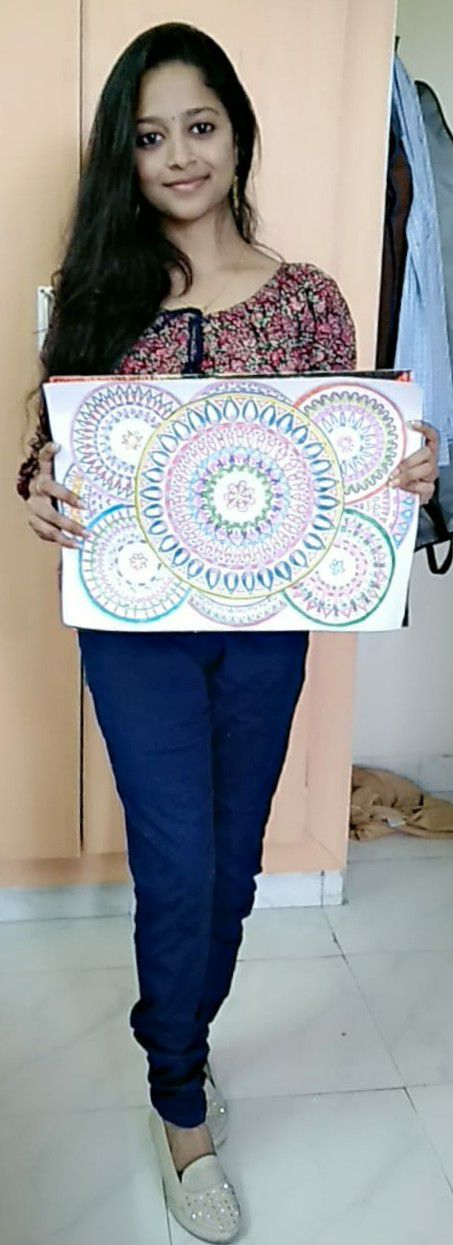 narayanee posing with her art