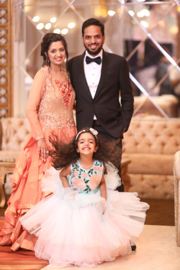 megha with her husband and daughter
