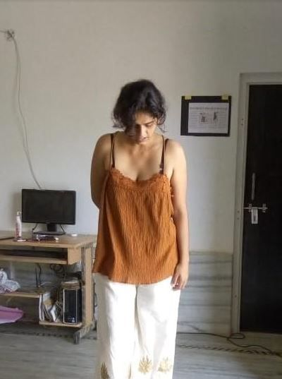 ganita wearing a top
