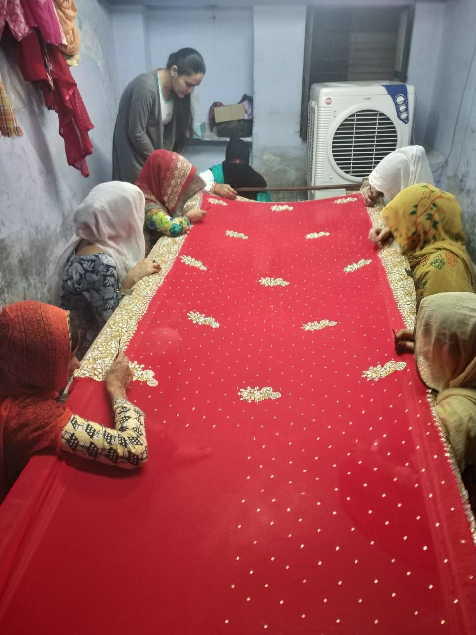 farnaz working with her team of women